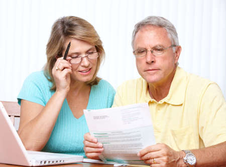 bill payment: Senior couple  working with laptop at home
