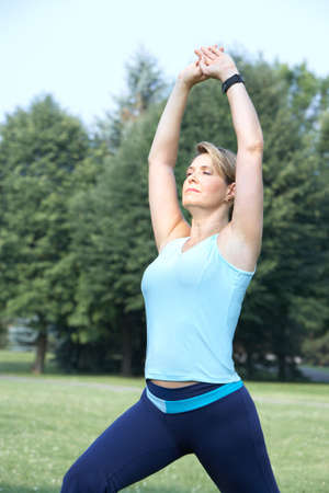 Mature woman  working out in park Stock Photo - 7364993