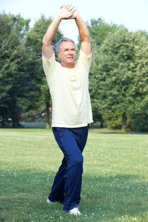 Elderly man  working out in park
