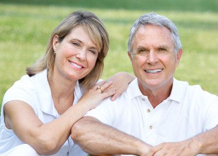 retire: Happy elderly seniors couple in park  Stock Photo