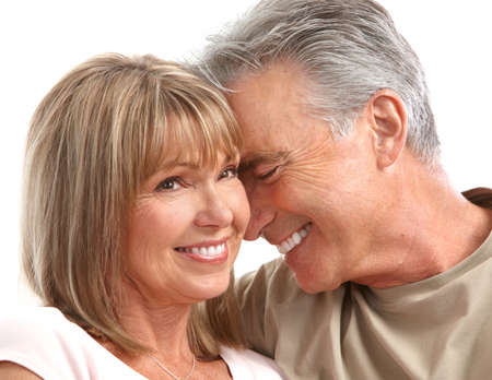 Happy seniors couple in love. Healthy teeth. Isolated over white background Stock Photo - 7415131