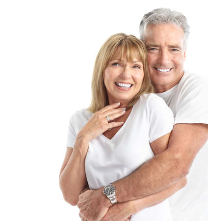 older person: Happy seniors couple in love. Healthy teeth. Isolated over white background  Stock Photo