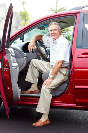 Smiling happy senior man  in the car  Stock Photo