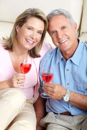 Seniors couple at home smiling and happy  photo