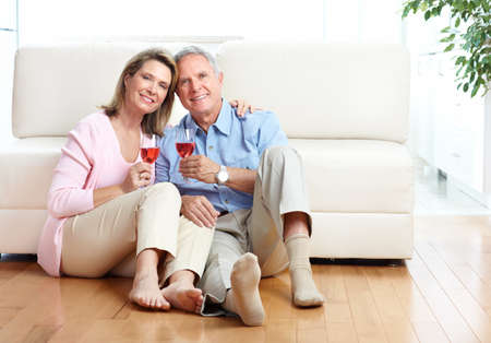 white wine: Seniors couple at home smiling and happy