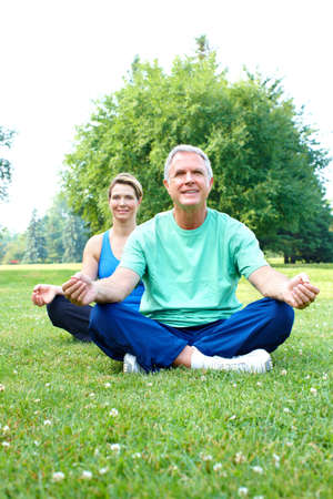 Happy elderly senior couple doing yoga  photo