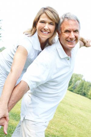 Happy elderly senior couple in park  photo