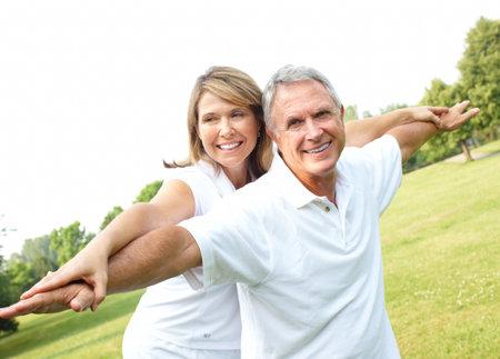 old man walking: Happy elderly senior couple in park  Stock Photo