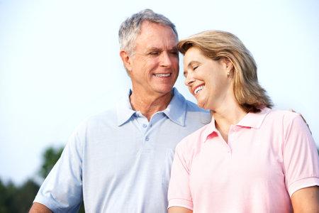 Happy elderly senior couple in park  Imagens