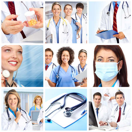 dentists clinic: smiling medical doctors with stethoscopes   Stock Photo