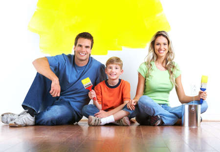 Renovation. Young family painting interior wall of home. Stock Photo - 7447119