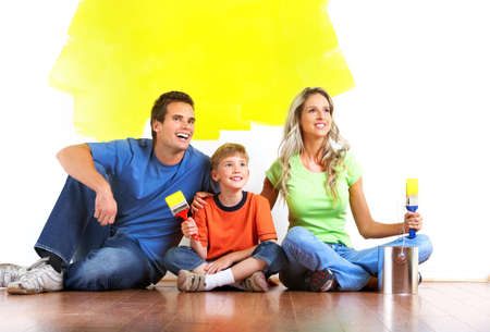 Renovation. Young family painting interior wall of home. Stock Photo - 7447125
