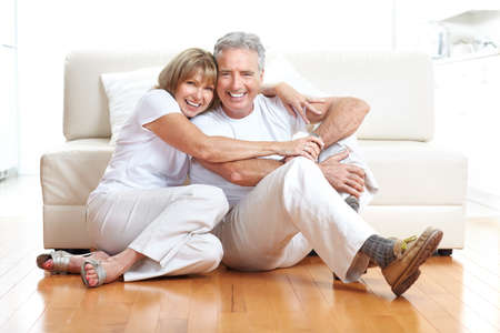 Senior couple at home smiling and happy  photo
