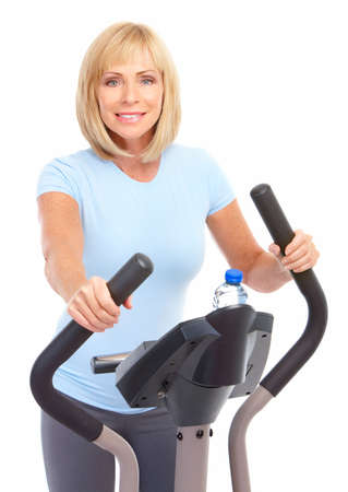 Gym & Fitness. Smiling elderly woman working out. Isolated over white background Stock Photo - 7465754