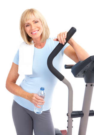 equipment: Gym & Fitness. Smiling elderly woman working out. Isolated over white background