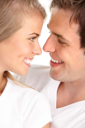 Happy smiling couple in love. Over white background Stock Photo - 7465791