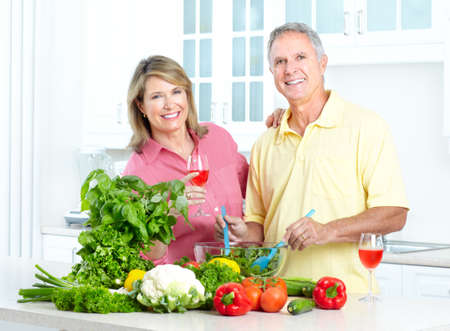 Happy seniors couple cooking at kitchen Stock Photo - 7465750