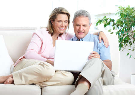 male senior adult: Senior couple  working with laptop at home