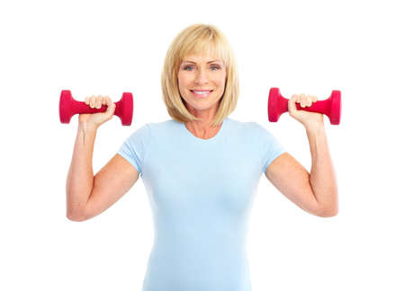 Gym & Fitness. Smiling elderly woman working out. Isolated over white background Stock Photo - 7465737