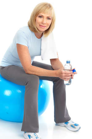 svelte: Gym & Fitness. Smiling elderly woman working out. Isolated over white background