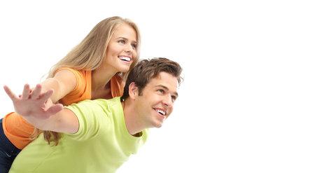 pareja de adolescentes: Happy sonriente pareja de enamorados. Sobre fondo blanco  Foto de archivo
