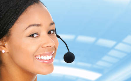 Beautiful  call center operator with headset. Isolated over white background  Stock Photo - 7465745