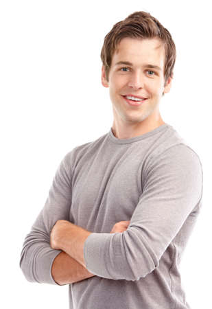 smiling young man: Handsome young man smiling. Isolated over white background