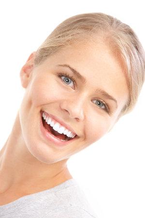 healthy teeth: Hermosa joven sonriente. Aislados sobre fondo blanco  Foto de archivo