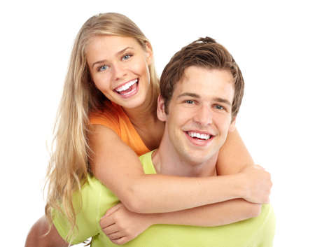 teen love: Happy smiling couple in love. Over white background