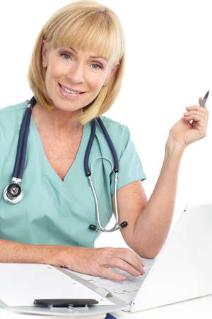 Smiling medical doctor woman with laptop. Isolated over white background  photo