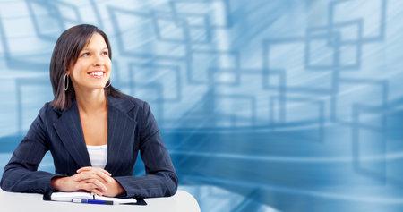 ビジネスの女性の笑みを浮かべてください。抽象的な背景が青で 写真素材