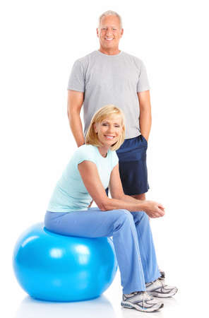 Gym & Fitness. Smiling elderly couple working out. Isolated over white background Stock Photo - 7513392
