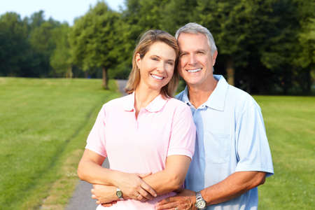 older women: Happy elderly senior couple in park  Stock Photo