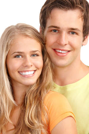Happy smiling couple in love. Over white background Stock Photo - 7552761