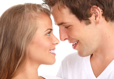 Happy smiling couple in love. Over white background Фото со стока