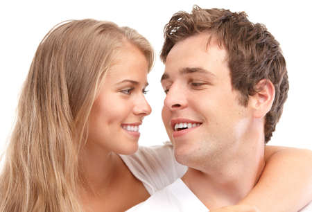 Happy smiling couple in love. Over white background Stock Photo - 7552754