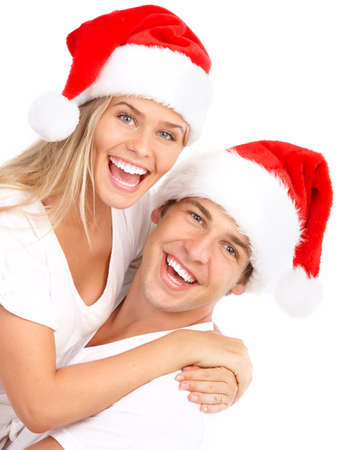 Young happy couple in Christmas hats. Isolated over white background Stock Photo - 7552637
