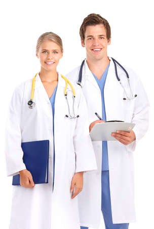 medical doctors: Smiling medical doctors with stethoscopes. Isolated over white background