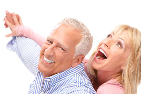 Happy seniors couple in love. Healthy teeth. Isolated over white background Stock Photo - 7552687
