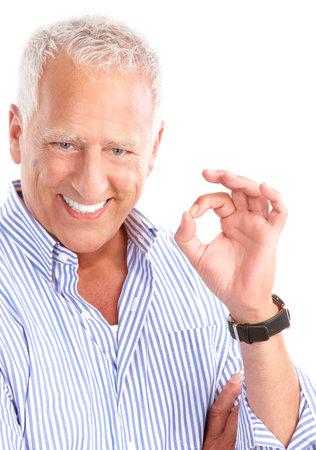 dental insurance: Smiling happy elderly man. Isolated over white background  Stock Photo