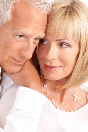 Happy elderly seniors couple in love. Isolated over white background  photo