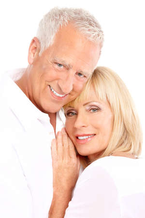 Happy seniors couple in love. Healthy teeth. Isolated over white background Stock Photo - 7552652