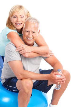fitness couple: Gym & Fitness. Smiling elderly couple working out. Isolated over white background