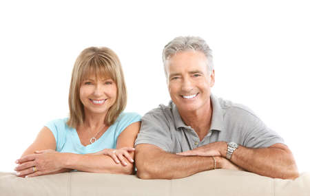 Happy seniors couple in love. Healthy teeth. Isolated over white background Stock Photo - 7552643
