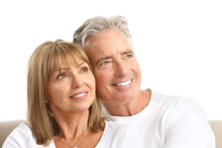 Happy seniors couple in love. Healthy teeth. Isolated over white background Stock Photo - 7552646