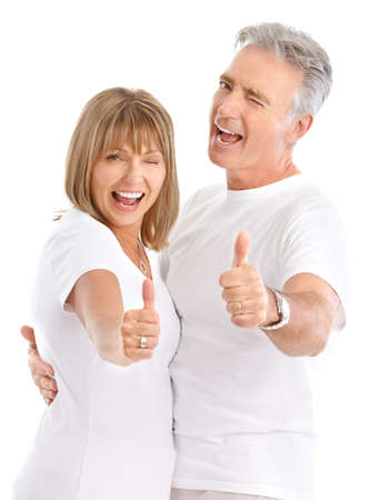 Happy elderly seniors couple in love. Isolated over white background