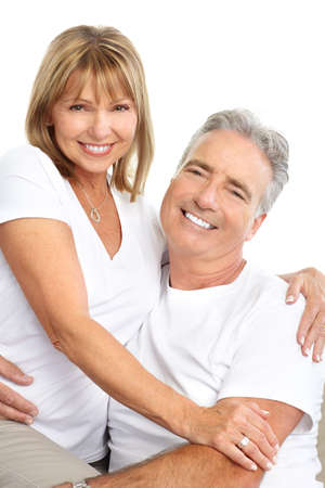Happy seniors couple in love. Healthy teeth. Isolated over white background Stock Photo - 7552724