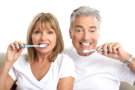 Happy seniors couple with toothbrushes. Healthy teeth. Isolated over white background Stock Photo - 7552721