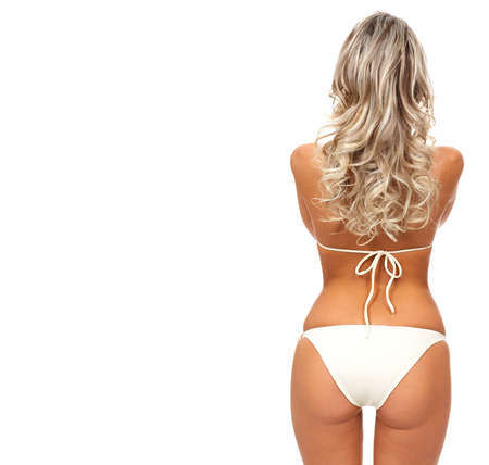 Sexy blonde woman. Isolated over white background Foto de archivo