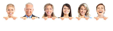 teeth smile: smiling people holding a white placard  Stock Photo